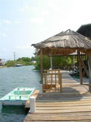 Caps Inn front dock with guests skiff